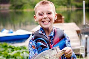 A Boy with a fish and huge smile